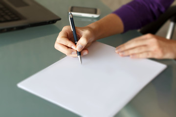 Businesswoman write with pen on blank paper