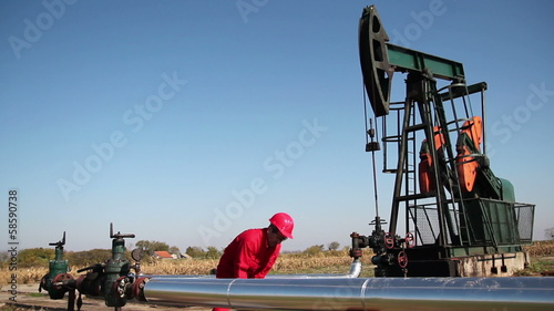 Oil Worker in Action With a Sledgehammer.