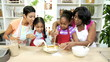 Little Ethnic Girls Enjoying Home Baking Lesson