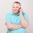 Senior man with phone over white
