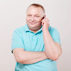 Senior man with phone over white