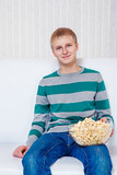 Teenager with popcorn