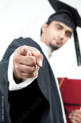 young male graduated pointing finger in the camera to motivate