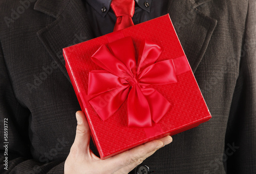 Man is holding a gift