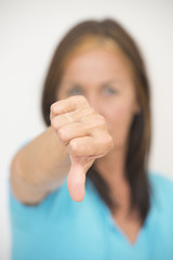 Thumb down gesture of negative woman
