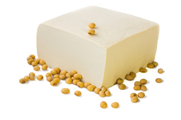Tofu and soybeans on white background.
