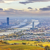 Cityscape of Vienna and Danube in the autumn at dusk