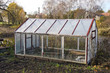 greenhouse construction in autumn garden