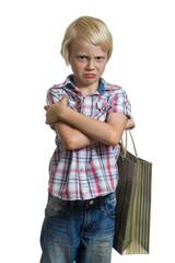 Sulking child holding gift bag