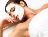 Beautiful Woman Getting Spa Treatment. Cosmetic Mask on Face.