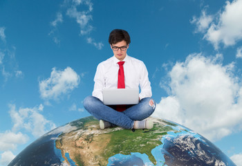 Businessman sitting on the earth (america)