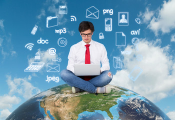 Businessman sitting on the earth (america)
