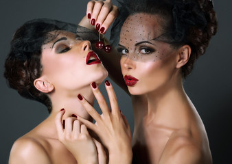 Dainty. Two Provocative Women with Cherry Berries. Temptation