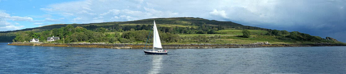 sailboat on a Scottish loch, beautiful hills in background