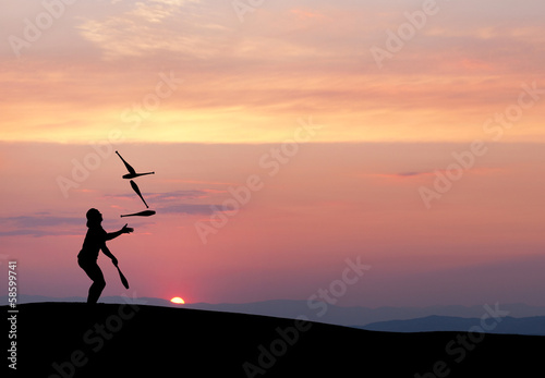 silhouette of juggler in sunset