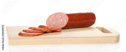 Appetizing sausage on the chopping board