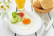 Breakfast with fried egg and orange juice