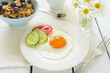 Healthy breakfast with fried egg and muesli