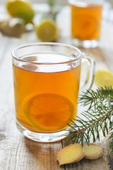 Mug with lemon and ginger tea