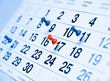 Leinwandbild Motiv Closeup a blue toned calendar page with drawing-pins