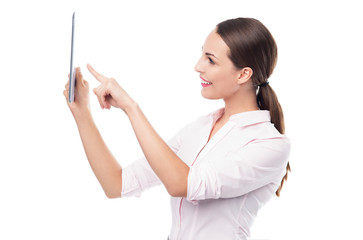 Woman pointing at digital tablet