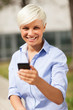 Portrait of blonde businesswoman with mobile phone