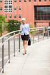 Businesswoman is walking while phoning