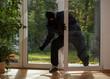 Burglar entering through the balcony window - 58605560