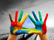 Painted colorful hands showing way to colorful happy life