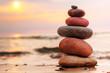 Stones pyramid on sand symbolizing zen, harmony, balance - 58606126