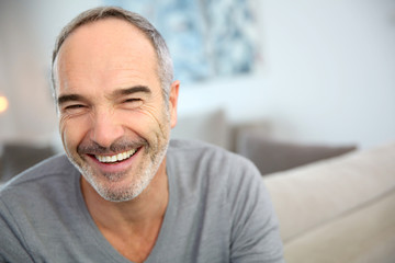 Portrait of happy handsome mature man
