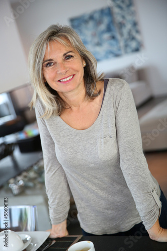 Senior woman at home looking at camera