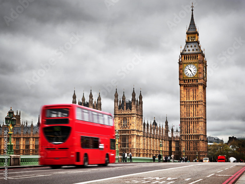 London, the UK. Red bus in motion and Big Ben - 58606336