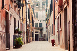 A narrow, old street in Venice, Italy