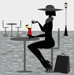 silhouette femminile seduta in un bar