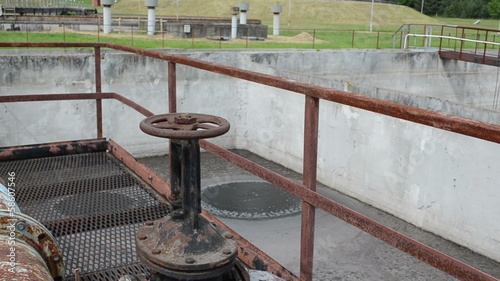 Rusty big tap and pipes and water treatment dirty liquid bubble
