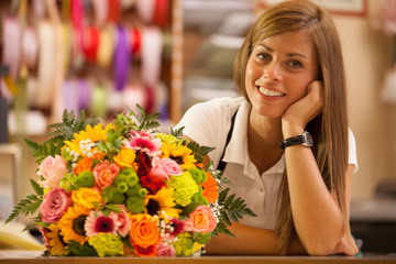 Beautiful smiling florist with colorful bouquet
