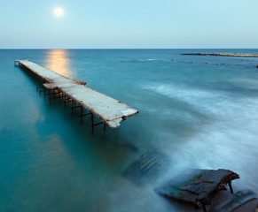 Ruined pier, Moon Path and evening coastline (Bulgaria).