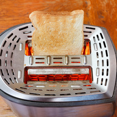 prepared toast on hot metal toaster