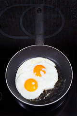 two prepared fried eggs in frying pan