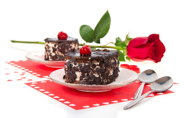 Chocolate cherry cakes and red rose