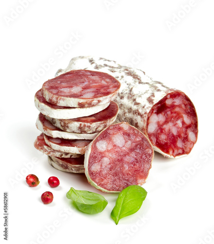 stacked sliced salami isolated on white