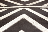 White Painted Pedestrian Crossing On Asphalt Roadway