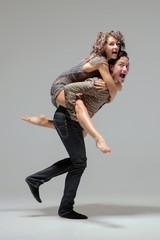 Playful fashionable young couple