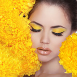 Beauty Portrait. Beautiful Spa Woman over yellow flowers. Eyes.
