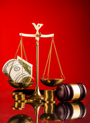 gavel, money , and scales of justice