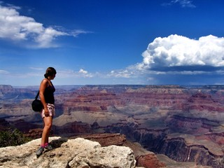 woman looking out over grand canyon usa