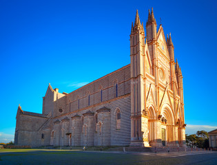 Orvieto medieval Duomo cathedral church on sunset. Italy