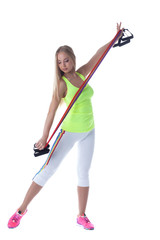 Athletic blonde exercising with stretching trainer