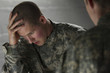Emotional military man consoled by peer, horizontal